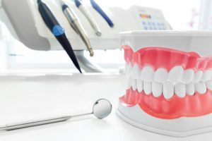 Clean teeth dental jaw model, mirror and dentistry instruments in dentist's office